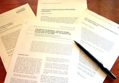 Articles on desk with pen